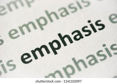 word emphasis printed on white paper macro