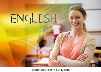 The word english against pretty teacher smiling at camera at back of classroom