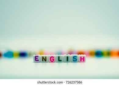 "Word ""English"" from letter beads for learning concept, selective focus and added color filter"