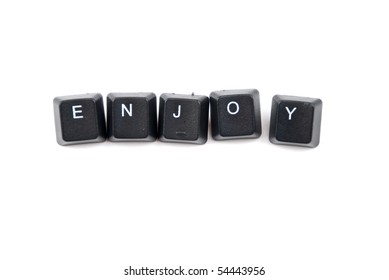 Word enjoy composed with black letters of computer keyboard isolated on white background,copy space for text message