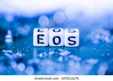 Word EOS formed by alphabet blocks on mother cryptocurrency