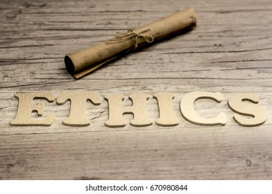 The word ETHICS is assembled with wooden letters