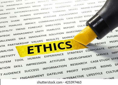 Word ETHICS highlighted with marker on paper of other related words.business success concept.