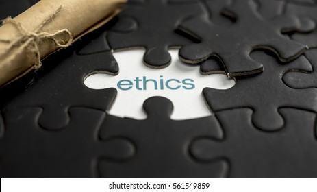 Word ethics under jigsaw puzzle piece