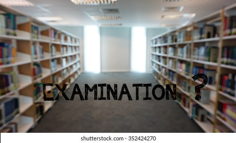 "The word ""examination"" in a background of blurry library books shelves."