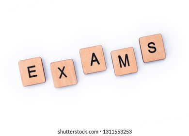The word EXAMS, spelt with wooden letter tiles.