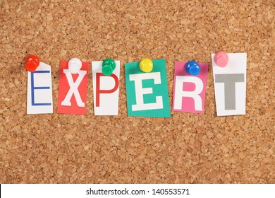 The word Expert in cut out magazine letters pinned to a cork notice board