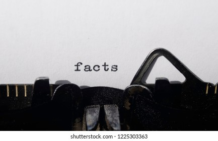 the word facts on old typewriter