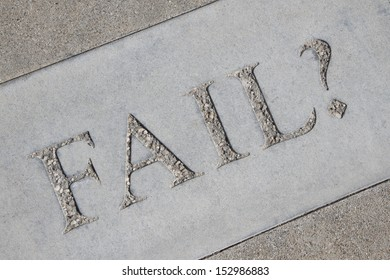 The word Fail with a question mark stenciled in concrete.
