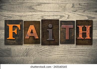 "The word ""FAITH"" written in wooden letterpress type."