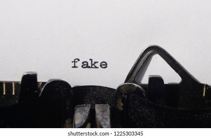 the word fake on old typewriter