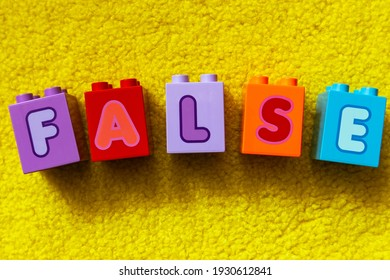 The word FALSE made of colored cubes. Colored cubes with letters FALSE