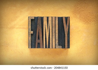 The word FAMILY written in vintage letterpress type