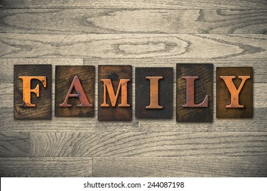 "The word ""FAMILY"" written in wooden letterpress type."