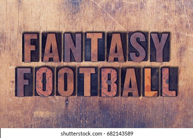 The word Fantasy Football concept and theme written in vintage wooden letterpress type on a grunge background.