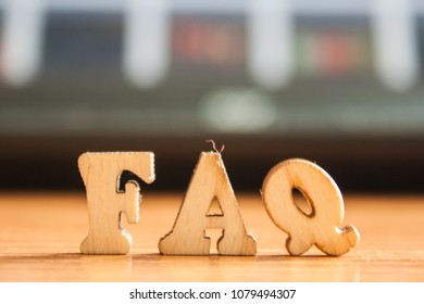 The word 'faq' made of wooden letters. wood inscription on table