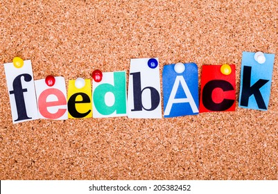 The word Feedback in cut out magazine letters pinned to a cork notice board