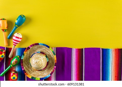 Word Fiesta on a bright painted wood background.