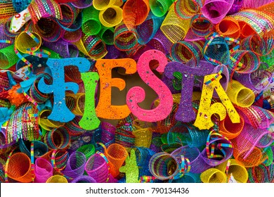 The word 'fiesta' written in colorful letters with glitter and m
