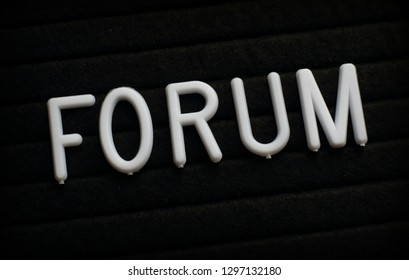 The word Forum in white plastic letters on a black letter board