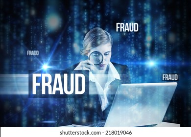 The word fraud and redhead businesswoman using her laptop against lines of blue blurred letters falling