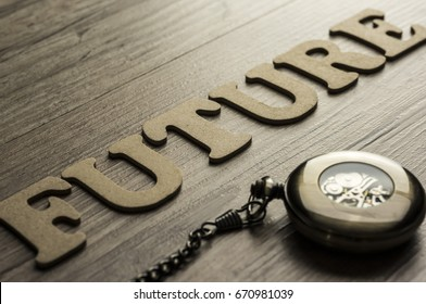 Word future assebled with alphabet letters and pocket watch