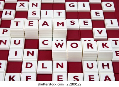 """A word game spelling out the words """"team work"""" among many letters."""