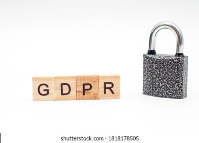 Word General Data Protection Regulation (GDPR) made from wooden blocks and metal Padlock on white background.