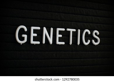 The word Genetics in white plastic letters on a black letter board