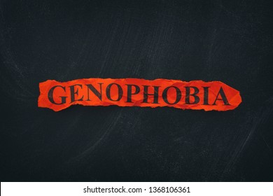 Word Genophobia on red torn piece of paper. Close up.