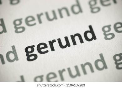 word gerund printed on white paper macro