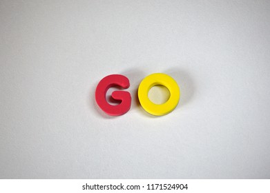 Word GO from colorful 3D foam letters on white background