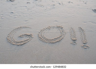 "word ""go"" written in the sand on the beach"