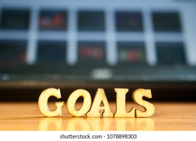 The word 'goals' made of wooden letters. wood inscription on table