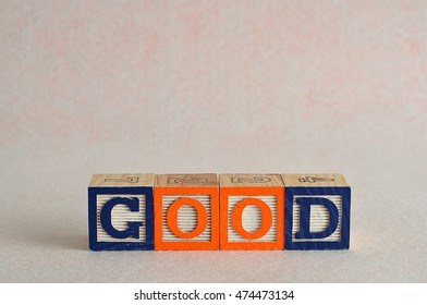 The word good spelled with colorful blocks isolated on a white background