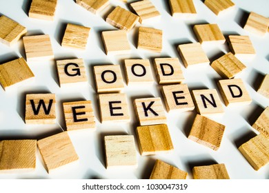 WORD GOOD WEEKEND. Wooden letters spelling the word GOOD WEEKEND on white background.
