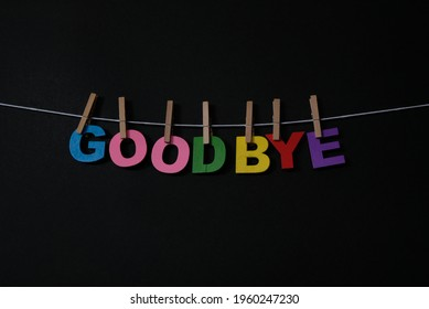 Word Goodbye on black background. Goodbye used when you are leaving or when someone is leaving you.Concept for art, learning, and education.