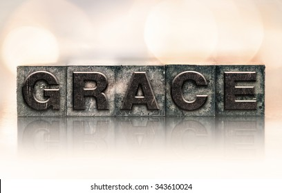"The word ""GRACE"" written in vintage ink stained letterpress type."