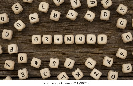 Word GRAMMAR written on wood block,stock image