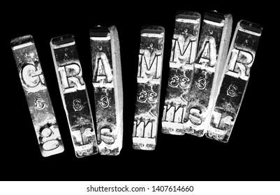 the word GRAMMER  with old typwriter keys  monochrome