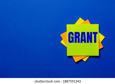 The word GRANT is written on bright stickers on a blue background