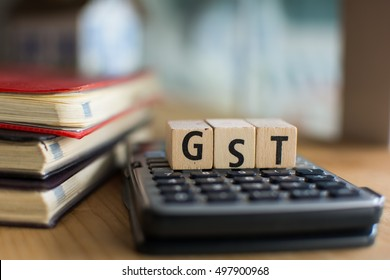 Word of GST spelled with colorful wooden alphabet blocks.Selective focus,shallow depth of field