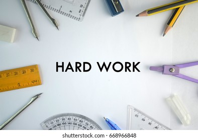 word hard work for motivation on student equipment on white background