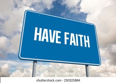 The word have faith and blue billboard against blue sky with white clouds