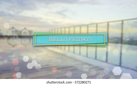 Word HELLO FRIDAY! on blurred background of sunrise over an infinity swimming pool