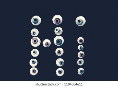 "The word ""hello"" from Googly Eyes. Background for Halloween."