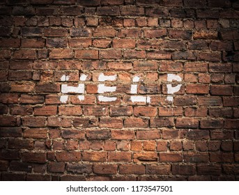 The Word Help Written As Graffiti On A Vintage Red Brick Wall