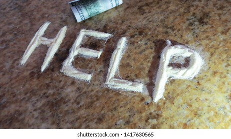 "The word ""help"" is written to highlight issues of dependency, addiction, and feeling helpless in regards to cocaine use. Vitamin C was used to create the appearance of the drug."