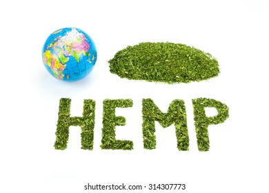 Word HEMP made of green tea leaves with world globe isolated on white background