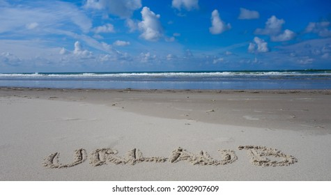 """Word Holidays german """"Urlaub"""" in Front of Horizon with Sea - Shutterstock ID 2002907609"""